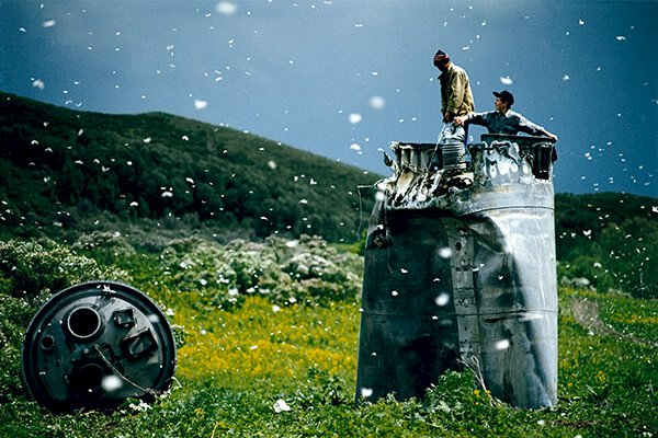 Villagers collecting scrap from a crashed spacecraft, Altai Territory, Russia, 2000 ©Jonas Bendiksen/Magnum Photos