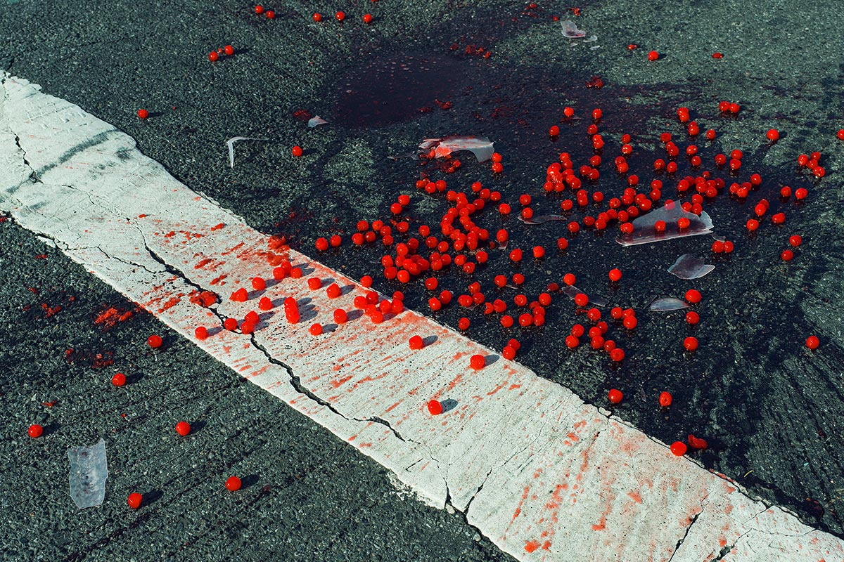Cherries spilled on crosswalk, New York City, USA, 2014 © Christopher Anderson / Magnum Photos